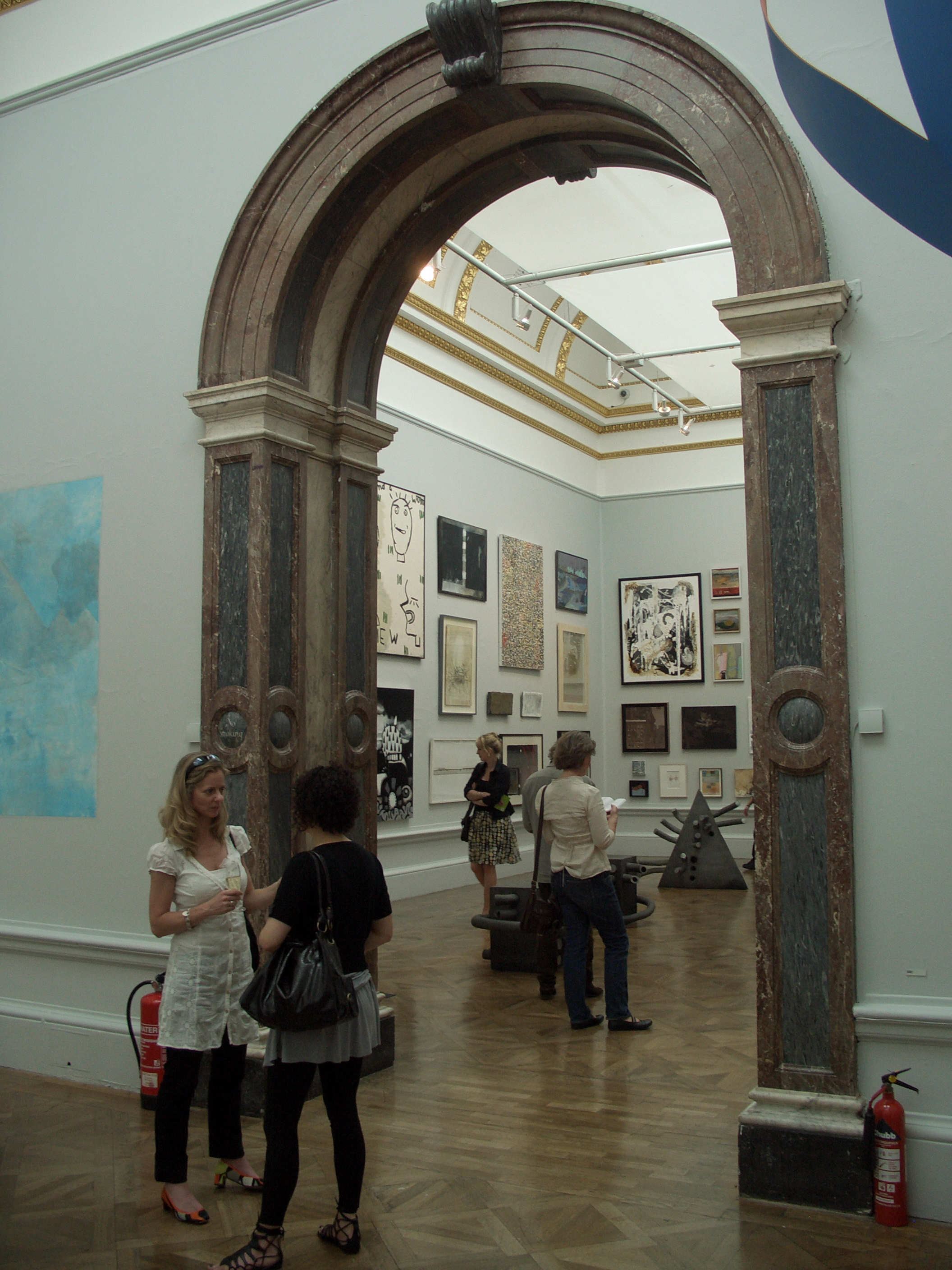 Framed by the gallery's marble arches