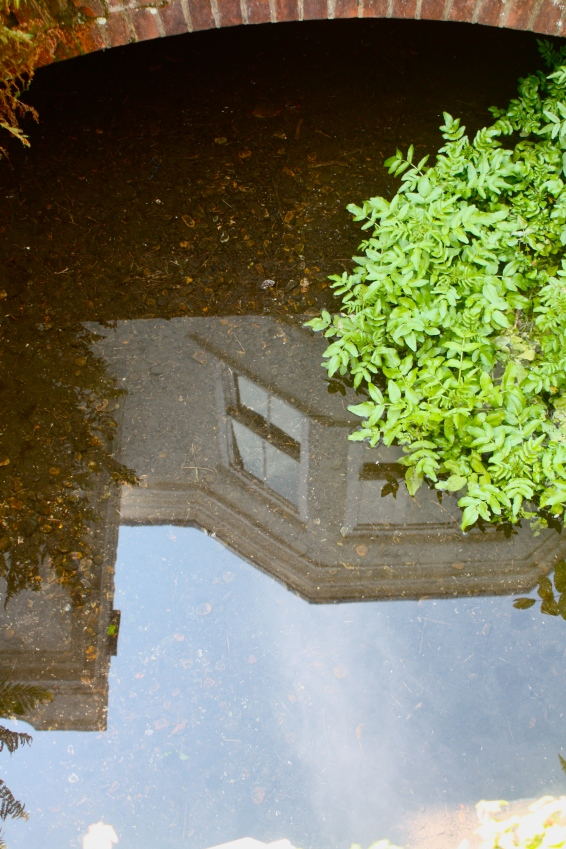 Honeywood Museum, turrets reflected in the culvert